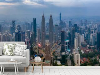 KUALA LUMPUR, MALAYSIA - MARCH 9, 2019: Dramatic aerial panorama photograph of Kuala Lumpur city skyline during hazy sunrise.