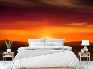 Illustration of orange sunset with far away mountain range and South Africa safari landscape.