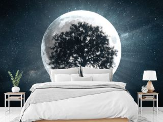 3d illustration of tree against the background of a full moon and a rotating universe around