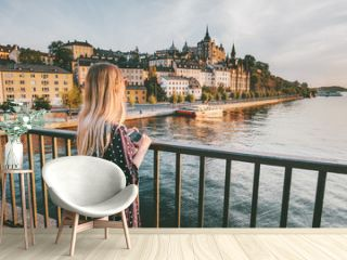 Tourist woman sightseeing Stockholm city enjoying view traveling lifestyle summer vacations in Sweden