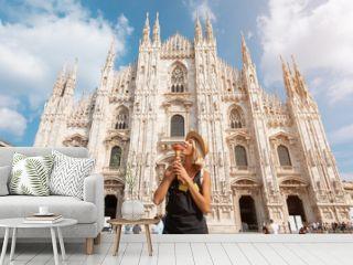 Happy traveler girl in Milan city. Tourist woman posing near Duomo cathedral in Milan, Italy, Europe
