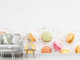 Brignt macarons for sweet break on white background top view mock up
