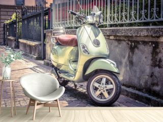 Scooter parked on old street. Vintage style photo. Motorbike is one of the most popular transport in Europe.