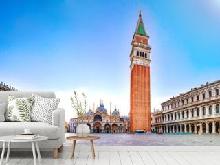Sunrise in San Marco square with Campanile and San Marco's Basilica. Panorama of the main square of the Old town. Venice, Veneto, Italy.