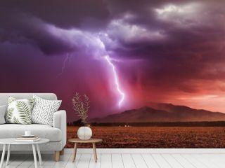 Lightning bolt striking a mountain in a storm