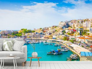 Panoramic view of Mikrolimano with colorful houses along the marina in Piraeus, Greece.