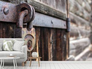 old hanging rusty iron lock on wooden door