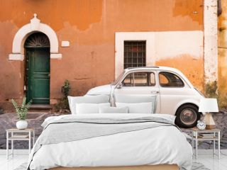 Vintage car parked in a cozy street in Trastevere, Rome, Italy, Europe.