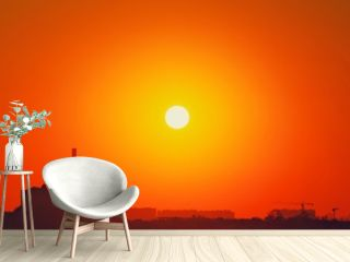 Heatwave hot sun. Global warming llimate change. Summer background with a magnificent summer sun. Autumn sunset. The setting sun in a clear sky. Hot city weather concept. High temperature at summer.