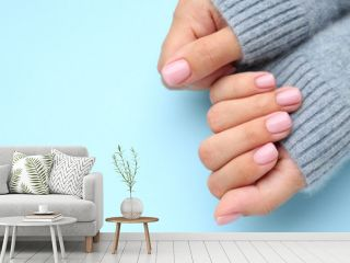 Hands of woman with beautiful manicure on color background