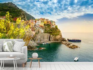 Manarola, Cinque Terre - romantic village with colorful houses on cliff over sea in Cinque Terre National Park