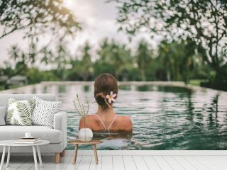 Infinity pool with a view on palm trees, Ubud, Bali