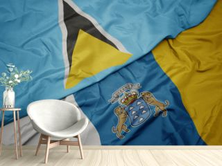 waving colorful flag of canary islands and national flag of saint lucia.