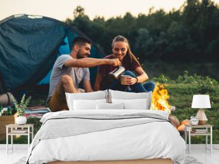 romantic couple on camping by the river outdoors