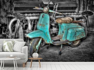 A pic of a very old turquoise scooter