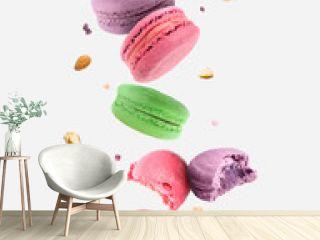 Falling tasty macarons on white background