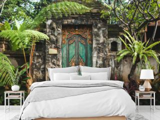 Traditional balinese handmade carved wooden door. Bali style furniture with ornament details. Old and vintage local style of architecture in Bali. Handmade details.