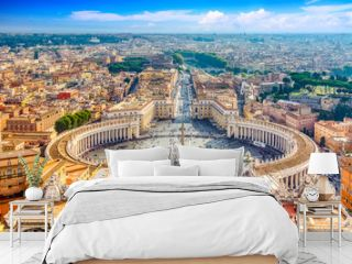 Famous Saint Peter's Square in Vatican and aerial view of the Rome city during sunny day.