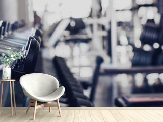gym interior background of dumbbells on rack in fitness and workout