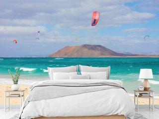 Beautiful view of Corralejo Dunas beach with Lobos Island and kitesurfers, Fuerteventura, Canary Islands