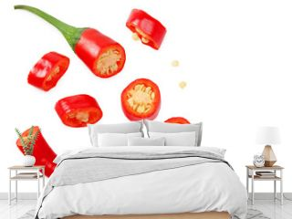 sliced red hot chili peppers isolated on white background. top view