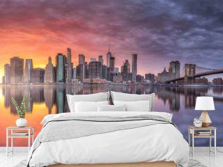 New york skyline reflection on the Hudson river at Brooklyn bridge at sunset
