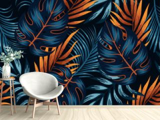 Botanical seamless tropical pattern with bright yellow and blue plants and leaves on a black background. Jungle leaf seamless vector floral pattern background.  Beautiful exotic plants.