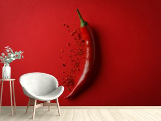 Tasty chilli pepper and powder spice on red background