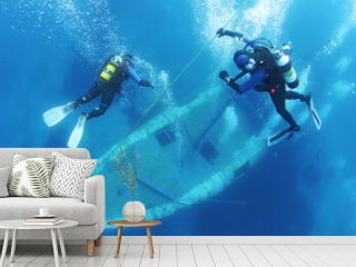 Scuba Divers go down the rope and Exploring underwater ship wreck