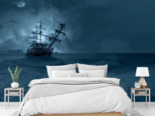Sailing old ship in storm sea on the background heavy clouds with lightning