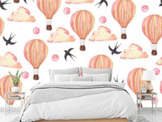 Seamless pattern with pink hot air balloons, pink clouds and birds on white background. Hand drawn watercolor illustration.