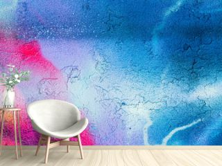 A fragment of colorful graffiti painted on a concrete wall. Abstract urban backdrop for design.