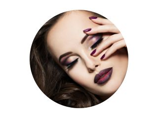 Beautiful face of   woman with maroon makeup and nails