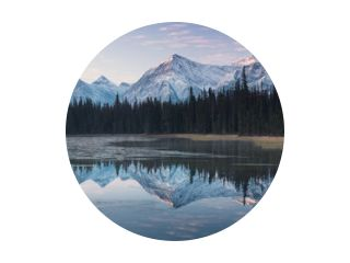 Almost nearly perfect reflection of the Rocky mountains in the Bow River. Near Canmore, Alberta Canada. Winter season is coming. Bear country. Beautiful landscape background concept.