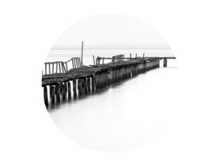 Long exposure view of wooden bridge in back and white background