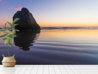 Beautiful seascape. A lonely rock in the ocean is reflected in the water. Sunset. The sky is colored orange. Calm. There are no people in the photo. There is an empty space for insertion. Recreation.