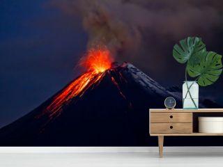 Tungurahua Volcano eruption with blue skies and lava