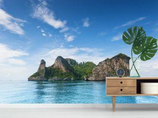 Thailand Chicken Head island cliff over ocean water during tourist boat trip in Railay Beach resort