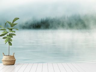 Heavy fog in the early morning on a mountain lake  Early morning on Yazevoe lake in Altai mountains, Kazakhstan