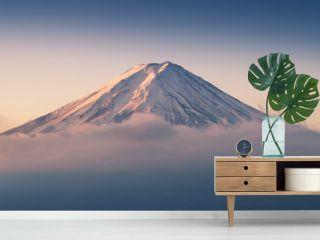 Mount Fuji enshrouded in clouds with clear sky from lake kawaguchi, Yamanashi, Japan