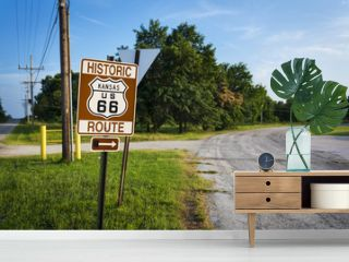 Historic Route 66 road sign in a strecht of the original road in the State of Kansas, USA  Concept for travel in the USA and Road Trip