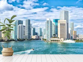 miami skyline. Yachts sail on sea water to city