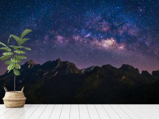 Night view of nature mountain with universe space of milky way galaxy and stars on sky