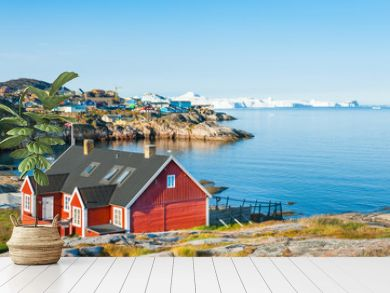 Colorful houses on the shore of Atlantic ocean in Ilulissat, western Greenland