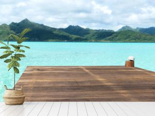 travel, seascape and nature concept - wooden pier on tropical beach in french polynesia