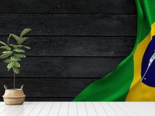 Flag of the Brazil, fabric on dark wood.