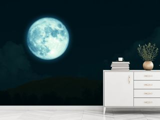 super full harvest moon on night sky back silhouette mountain
