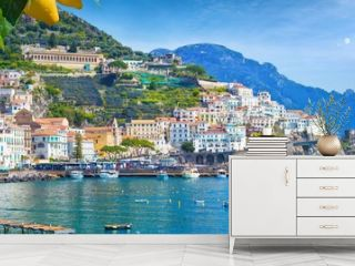 Panoramic view of beautiful Amalfi on hills leading down to coast, Campania, Italy. Amalfi coast is most popular travel and holiday destination in Europe.