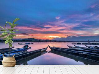 Mountain landscape, lake and mountain range, large lake and boat. Beautiful sunset reflected in the Lak lake, Buon Me Thuot, Vietnam