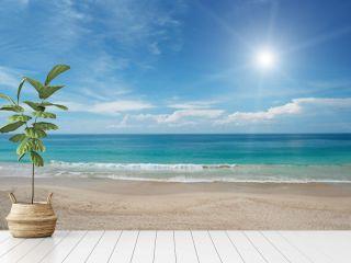 Sandy beach and sun in blue sky
